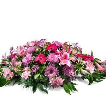 Almohadón en tonos rosas - Envío de Flores a Domicilio