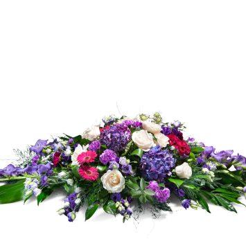 Almohadón en tonos morados - Envío de Flores a Domicilio