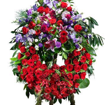 Corona Clasica en tonos rojos con cabecero - Envío de Flores a Domicilio