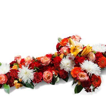 Cruz grande en tonos Naranjas - Envío de Flores a Domicilio