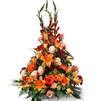 Centro vertical en tonos naranjas - Envío de Flores a Domicilio