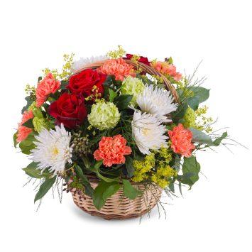 Cesta variada en tonos cálidos y verdes - Envío de Flores a Domicilio